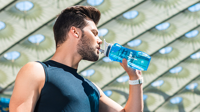 Athlete Drinking Out of Water Bottle
